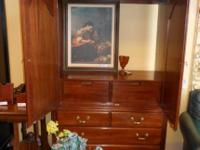 This amazing cabinet is manufactured by Ethan Allen.