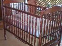 For sale: $100 Firm Cherry wood Bassett Baby crib and