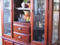 Beautiful cherry wood china hutch.  The top has a