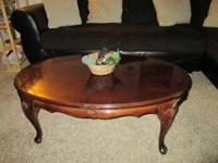 Cherry wood  engraved coffee table. Great condition.
