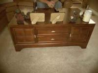 I am selling a cherry wood coffee table with 8
