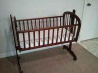 Infant cradle from target. Cherry wood. It has a pin