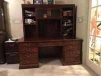 cherry wood desk with added top shelf. The desk is 30
