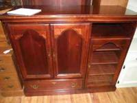 Beautiful cherry wood entertainment center. At a very