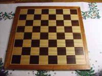 Wooden chess board. Contact  Location: Eight Mile
