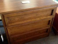 Dark-colored three-drawer chest of drawers. Just $50!