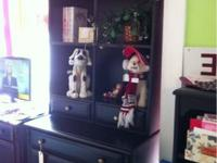 "Black 3 drawer chest that is 30"" tall and 19"" deep. The"