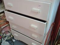 Four drawer cottage style chest painted white. Located