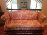 Red-and-white fabric toile sofa. Excellent condition.