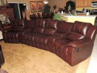 Here is a Beautiful Chestnut Leather Theater Style Quad