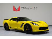 This beautiful Velocity Yellow Tintcoat ZO6 is as new