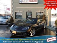 TAKE A LOOK AT THIS BLACK 2006 CHEVROLET CORVETTE WITH