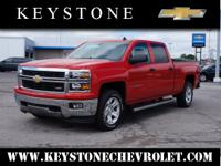 Feast your eyes on this red 2014 Chevrolet Silverado