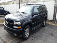 This is a 2004 Chevrolet Suburban 4x4 Fully LOADED.