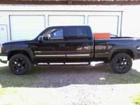 2004 Chevy 2500 4x4 black with leather interior 20 inch