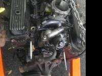 Complete motor with exhaust manifold and flywheel Call