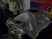 chevy intake it is a port sonig asking 100.00 call