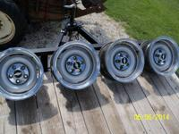 For Sale: 4 wheels with trim rings and center caps came