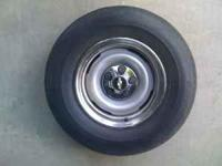 CHEVY RIMS/TIRE 5 LUG 235/75R15 TWO OF THEM HAVE TIRES