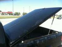 A.R.E. fiberglass bed cover for a Chevy S10, short bed,