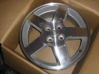 4 like new 16 inch chevy wheels 16 inch from front