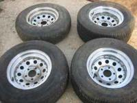 2 15x7 and 2 15 x 8 chrome modular rims and tires. The
