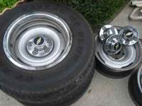 Rally Wheels with 2 mounted tires off 1988 Chevy truck.