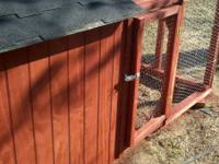 Redwood stained T-111 siding. Hindged nesting box on