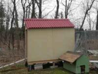 Chicken coup with 9 nesting boxes. On wheels for easy