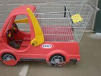 This is a shopping cart with a car for children to ride