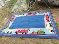 Fun and colorful rug with Trucks around the border This