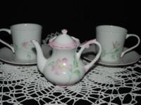 This beautiful little set includes a mini teapot (4 In.
