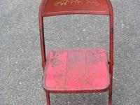 Youngster's vintage red metal folding chair in