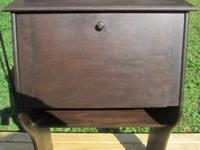 Dark wood finish, drop front, stand-up desk. Front