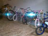 several different size children bicycles and adult