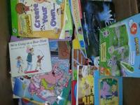 A box loaded with kids books pre-k with maybe 3rd