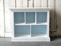 This handmade children's bookcase in crisp white with