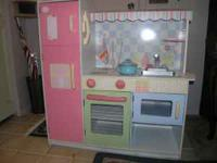 Adorable children's kitchen in pastel colors comes