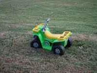 Small Kawasaki 4-wheeler with easy to operate push