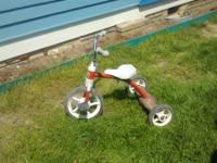 Children's red tricycle.