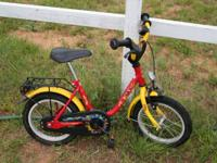 14 inch bicycle for children. The side-wheels are