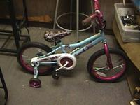 CHILDREN'S BICYCLES WITH TRAINING TIRES. LIKE BRAND NEW
