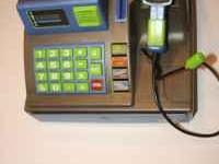 This is a childs cash register that comes with play