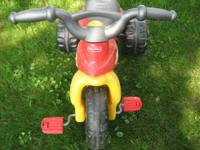 Childs Plastic 3 Wheeler by Fisher Price, has storage