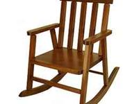 This is a childs oak rocking chair. It is vintage
