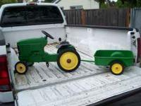 JOHN DEERE TRACTOR AND TRAILER $125.00  Location: NW