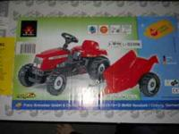 New childs pedal tractor still in box unopened for ages