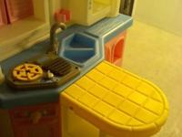 Childs toy kitchen with real sound for sale. Will
