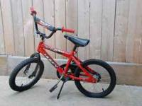Heavily used child's bicycle, it has another child