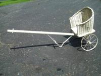 I have a childs wicker draw cart that you hook up to a